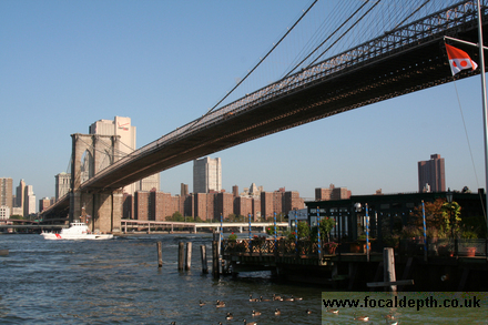 USA - Viewed from the Fulton Ferry Pier, looking across the Brooklyn Bridge to Manhattan