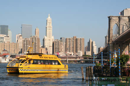 USA - Spanning the East River from Brooklyn to Manhattan, the Brooklyn Bridge, New York with water taxi .